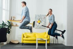 View of cheerful couple levitating on