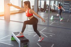 Adult sportswoman training with stepper royalty free stock photos