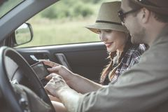 Optimistic couple is opening navigation system stock image