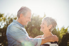 Side view of cheerful senior couple looking at each other stock photo