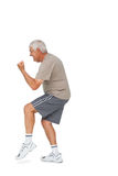 Side view of a cheerful senior man with clenched fist Royalty Free Stock Photos