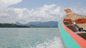 Side View on Cheow Lan Lake Water from Traditional Thai Long Tail Boat. HD Slowmotion. Phang Nga, Thailand. Side View on Cheow Lan Lake Water from Traditional stock footage