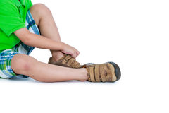 Side view of child put leather shoes on.  on white backg Stock Photo