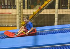 Child on slide ride in play area Royalty Free Stock Photography