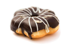 Side view chocolate flavor donut on white. Background Stock Photo
