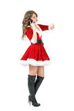 Side view of Christmas mrs. Claus on the phone checking time Royalty Free Stock Photography