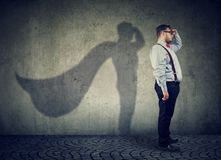 Chubby man posing as super hero. Side view of a chubby man imagining to be super hero looking aspired Stock Images