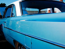 Side view of a classic. This is a side view of a 1960's era automobile. Primary color is light blue. Gas door is included in image Stock Photography