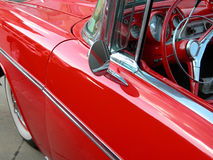 Side view of classic car. Showing the steering wheel and side view mirror Stock Photos