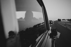 Classic car crossing a narrow road. Black and white. Royalty Free Stock Images