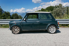 Side view of a classic Mini Cooper. A Limited Edition green Mini Cooper on a sunny day Stock Images