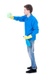 Side view of a cleaner man in gloves with sponge and detergent. Royalty Free Stock Images