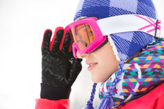 Side view close-up of beautiful young woman in ski goggles looking away Royalty Free Stock Photos