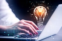 Technology and innovation concept. Side view and close up of businesswoman hands using laptop with abstract polygonal lamp. Technology and innovation concept. 3D Stock Photography