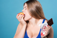 Side view close up of chubby lady eating apple Stock Photos