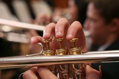 Side View Close-up of Man Playing Trumpet. Close-up view of man's fingers as he plays trumpet Royalty Free Stock Image