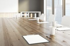 Meeting concept. Side view and close up of wooden conference table with clipboards and coffee cups. Meeting concept. 3D Rendering Stock Image