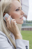 Side view close-up of young businesswoman using mobile phone Royalty Free Stock Photo