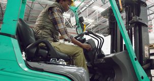 Female worker driving forklift in a warehouse stock footage