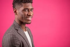 Portrait of happy Africanamerican male in grey suit jacket. Side view closeup portrait of happy Africanamerican male in grey suit jacket and white T-shirt stock photography