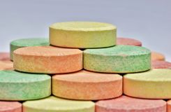 Colorful antacid pills in a pyramid. Side view of colorful antacid pills stacked into a pyramid. Popular for relieving stomach aches and indigestion Royalty Free Stock Photo