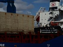 Container ship side view with open basement Stock Photo