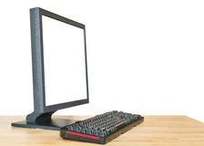 Side view computer display and keyboard on table Royalty Free Stock Photos