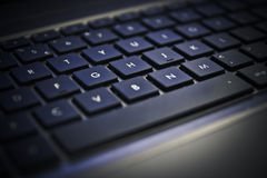 Side view of computer keyboard by night Royalty Free Stock Photography