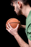 Side view of concentrated man holding basketball ball Royalty Free Stock Photography
