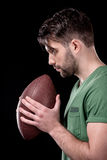 Side view of concentrated man holding rugby ball Royalty Free Stock Images