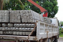 Side view of concrete pole pile load on a truck Royalty Free Stock Photos