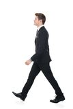 Side view of confident businessman walking Stock Images