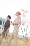 Side view of confident businesswomen walking against clear sky Stock Image