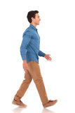 Side view of a confident casual man walking forward Stock Photography
