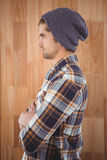 Side view of confident hipster with arms crossed Stock Images