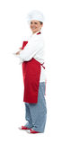 Side view of confident middle aged female chef Stock Images