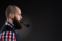 Side view of confident young bearded man Royalty Free Stock Photo