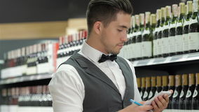 Side view of confident young sommelier