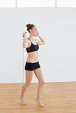 Side view of content sporty woman holding a skipping rope Royalty Free Stock Images