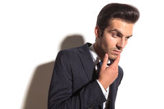 Side view of a cool business man's face thinking Royalty Free Stock Image