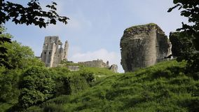 Side view Corfe Castle Dorset England uk. Corfe Castle Isle of Purbeck Dorset England built by William the Conqueror in 11th century in the Purbeck Hills between stock video footage