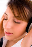 Side view of corporate female tuned to music Stock Photography