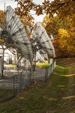 Side view of corporate satellite dishes in autumn Royalty Free Stock Photography