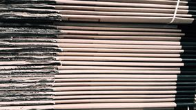 Side view of a corrugated cardboard pile in a factory stock footage