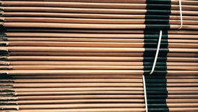 Side view of a corrugated cardboard pile in a factory. Side view of corrugated cardboard pile in a factory stock video footage