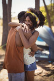 Side view of couple embracing while standing against tent Stock Photos
