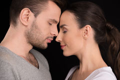 Side view of couple in love bonding to each other Royalty Free Stock Photos