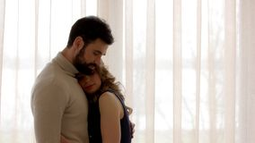 Side view of a couple. Man and woman, closed eyes. Facts about love stock video
