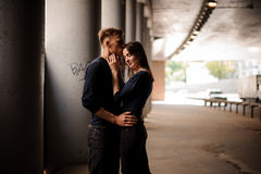 Side view of couple standing and hugging Stock Image