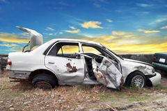 Side view of crash car. With blue sky, accident, vehicle, wreck, road, broken, automobile, white, transportation, front, old, metal, abandoned, background stock image